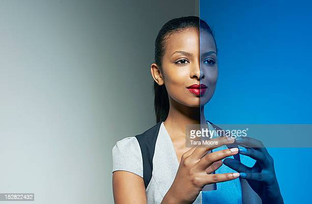 business woman with mirror image - symmetry stock photos and pictures