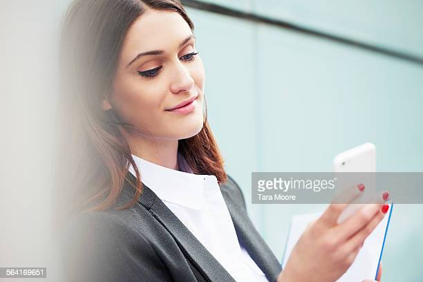 business woman with mobile phone and notebook - red nail polish stock pictures, royalty-free photos & images