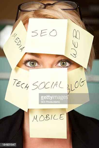 Business Woman With New Technology Notes On Face