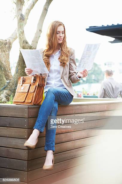 business woman with paperwork - brown jeans stock photos and pictures