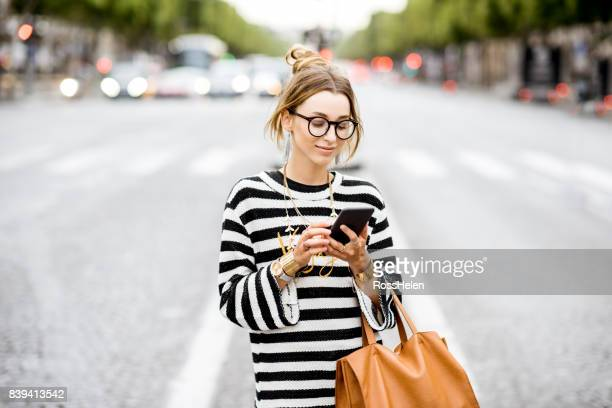 Business woman with phone on the street