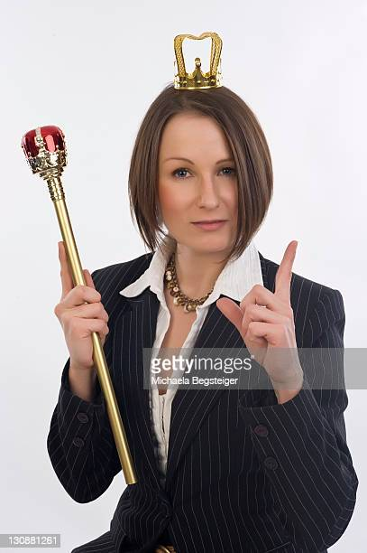Business woman, 30, with sceptre and crown