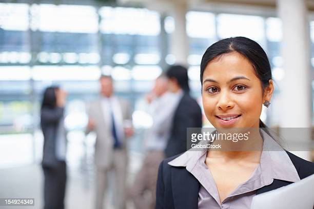 business woman with team in background - administrative professionals stock pictures, royalty-free photos & images