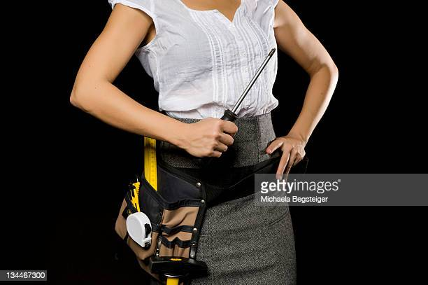 Business woman with tool belt