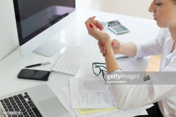 business woman with wrist pain - bones stock photos and pictures