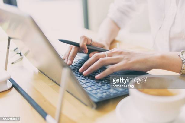 Business woman working and stretch oneself with the laptop computer