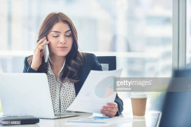 business woman working and talking on a mobile phone. - secretary stock photos and pictures