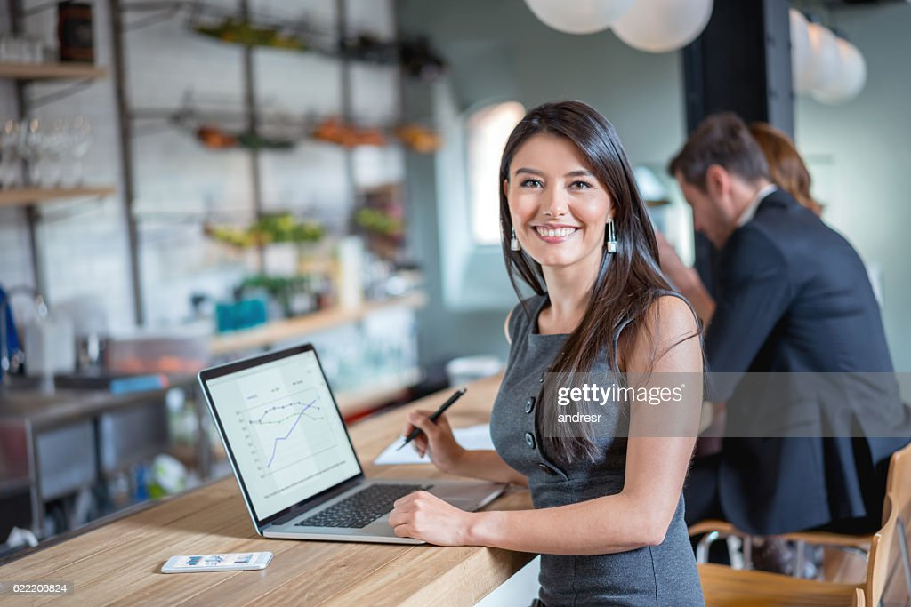 Business woman working at a cafe : Stock Photo