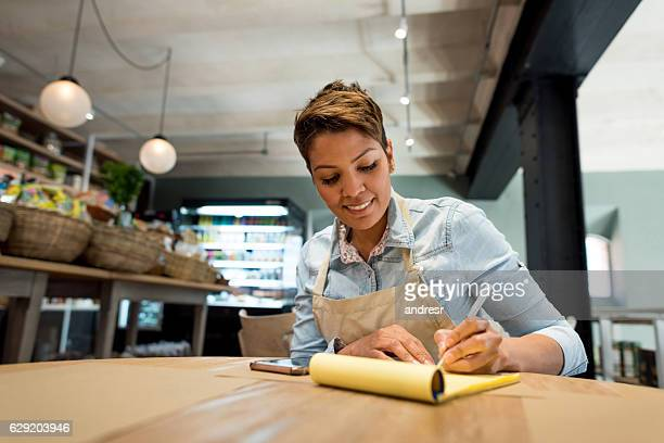 business woman working at a restaurant - business plan stock pictures, royalty-free photos & images