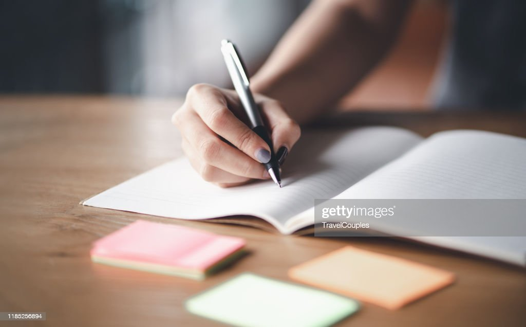 Business woman working at office with documents on his desk, Business woman holding pens and papers making notes in documents on the table, Hands of financial manager taking notes : Stock Photo
