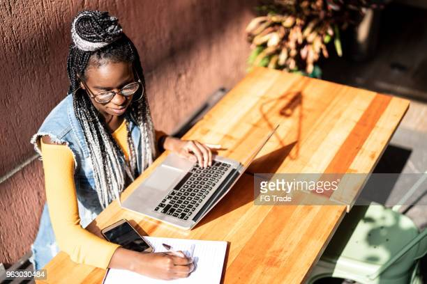 business woman working distance with laptop - remote location stock pictures, royalty-free photos & images