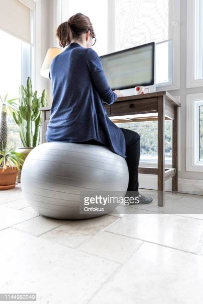 business woman working from home - fitness ball stock pictures, royalty-free photos & images