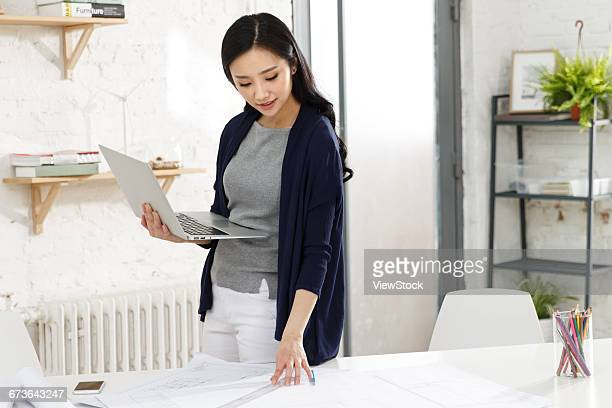 Business woman working in a studio