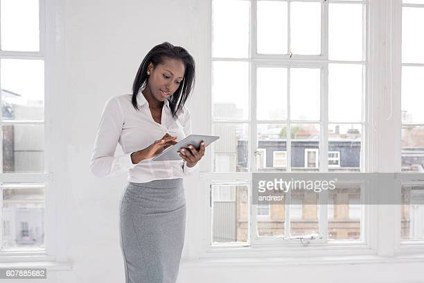Business woman working on a tablet computer