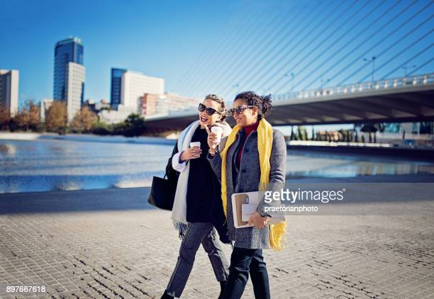 Business women are walking to their office