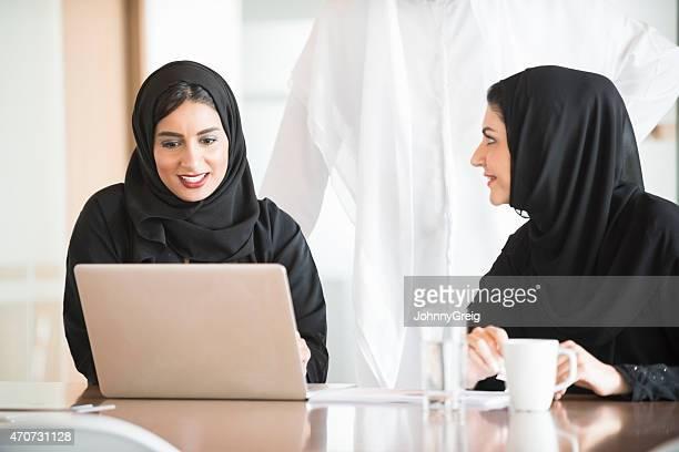 Business women at a meeting.
