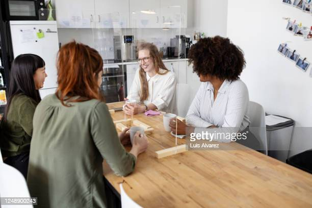 business women at office cafeteria with glass partition - distant stock pictures, royalty-free photos & images