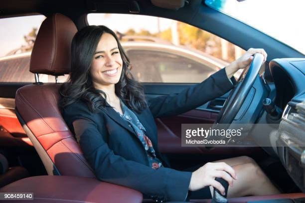 Business Women Commuting In Her Car