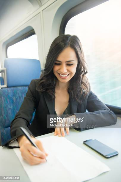 Business Women Commuting On The Train