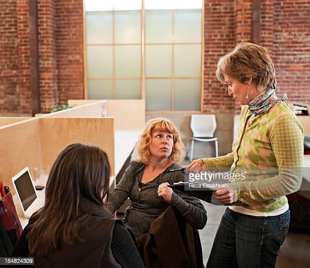 Business women discuss paperwork