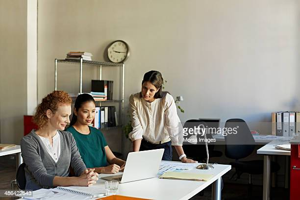Business women discussing project on computer