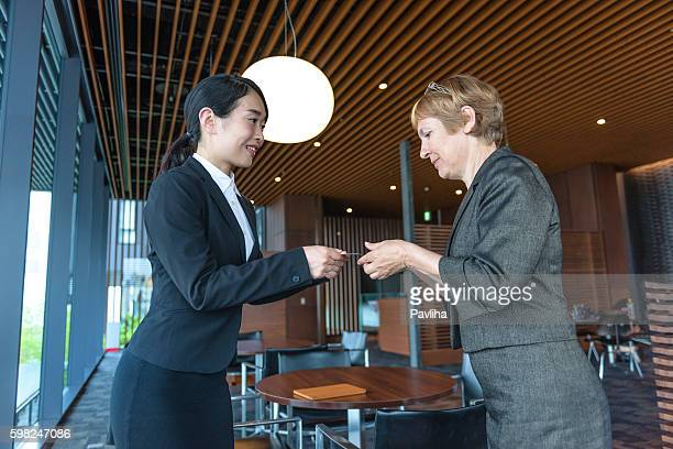 Business women exchanged business cards, Kyoto, Japan