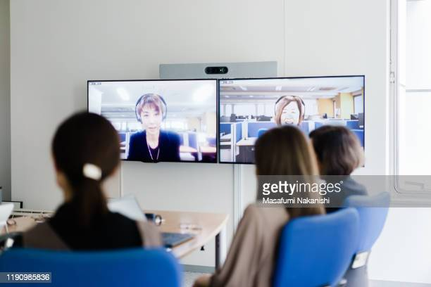 business women having a video conference. - テレビ会議 ストックフォトと画像