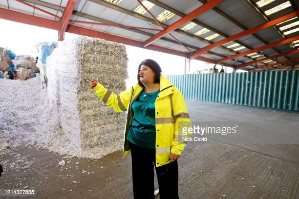 business women in high visibility jacket on site at a paper recycle warehouse. - femalefocuscollection stock pictures, royalty-free photos & images