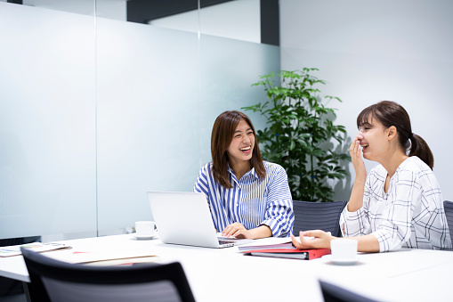 Business women looking at computer in office - gettyimageskorea