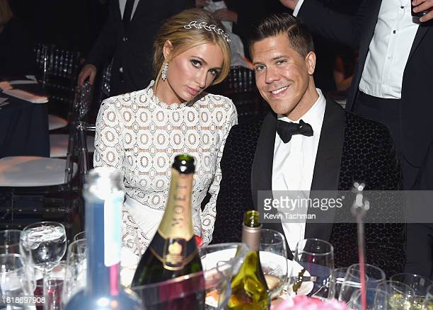 Business women Paris Hilton and TV personality/real estate broker Fredrik Eklund attend amfAR's Inspiration Gala at Milk Studios on October 27 2016...