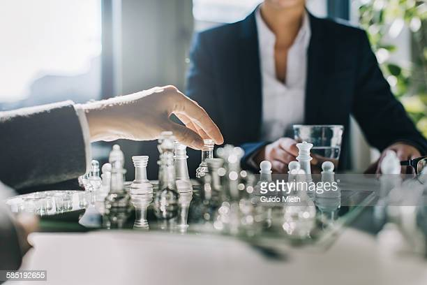 business women playing chess. - chess stock pictures, royalty-free photos & images