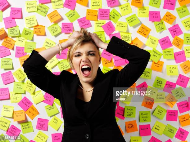 business women pulling her hair out - pulling hair stock photos and pictures