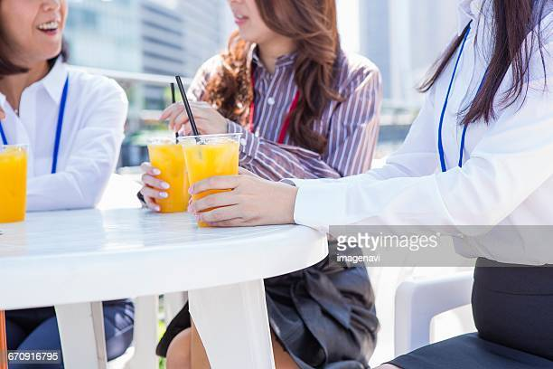 Business women sitting at an outdoor cafe