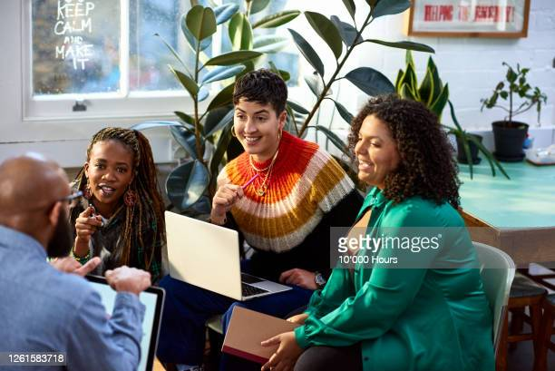 business women talking to male colleague, informal meeting - entrepreneur stock pictures, royalty-free photos & images