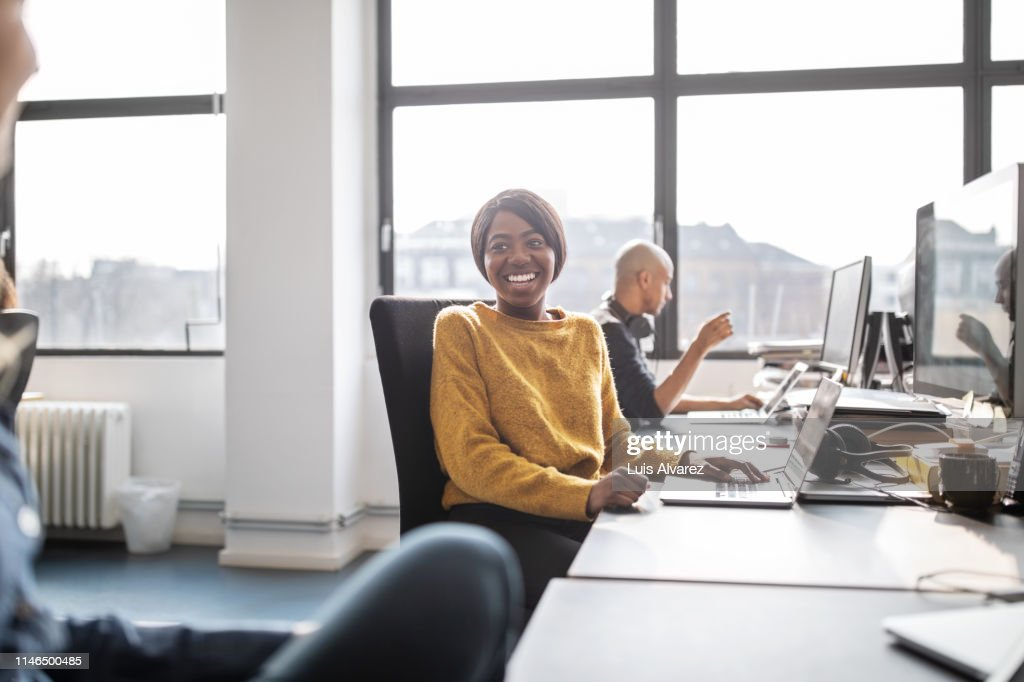 Business women talking while working in office : Stock Photo