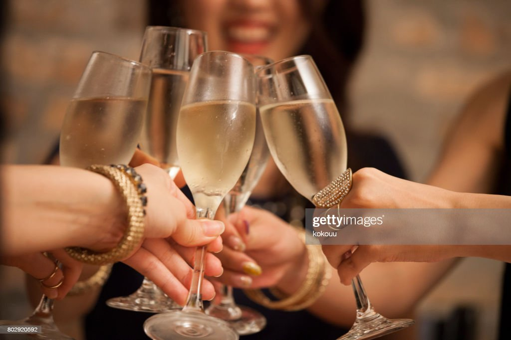 Business women toast with a glass of wine in hand. : Stock Photo