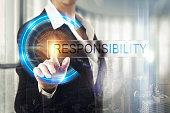 Business women touching the responsibility screen
