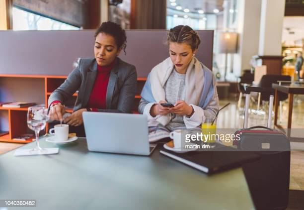 business women waiting for check in - geographical locations stock pictures, royalty-free photos & images