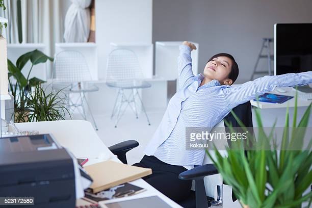 Business women who relax stretched out hand