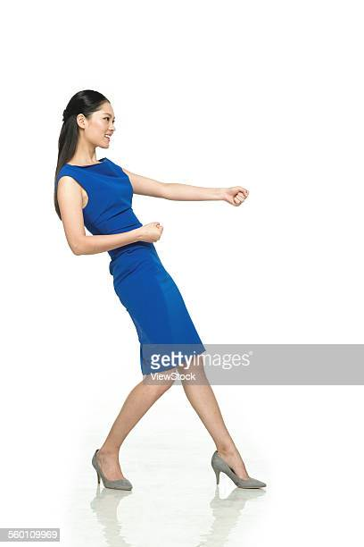 Business young woman do pull posture