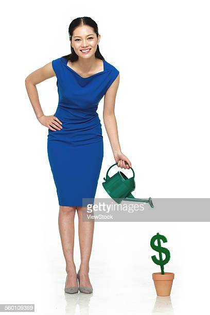Business young woman holding a water bottle