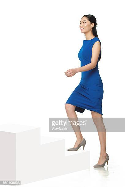 Business young woman on the stairs