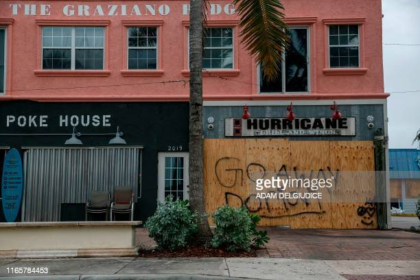 TOPSHOT Businesses are seen shuttered near Fort Pierce Jetty Park in Florida on September 2 2019 Monster storm Dorian stalled over the Bahamas Monday...