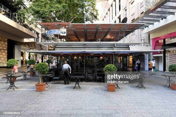 Businesses are seen shutting down early after Queensland Premier Annastacia Palazczuk announced a three-day lockdown for the Greater Brisbane area,...
