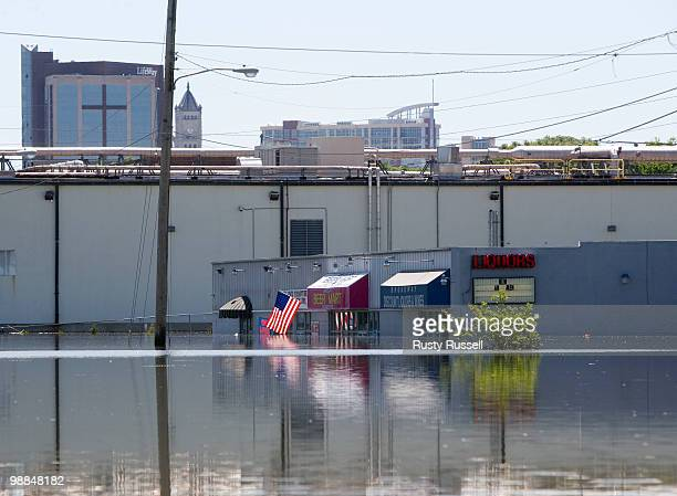 Businesses including one with its American flag still flying remain flooded May 4 2010 in Nashville Tennessee More than 13 inches of rain fell over...