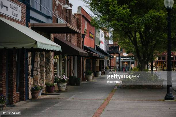 Businesses stand temporarily closed in downtown Cartersville Georgia US on Wednesday April 22 2020 Georgia is reopening for business more...