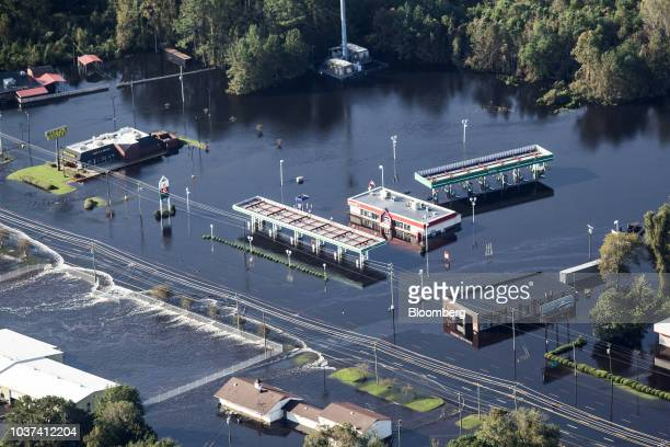 Businesses surrounded by floodwater are seen in this aerial photograph taken above Kinston North Carolina US on Friday Sept 21 2018 Record floods...