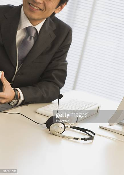 Businessman, a headset on the desk