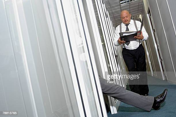 Businessman About to Be Tripped