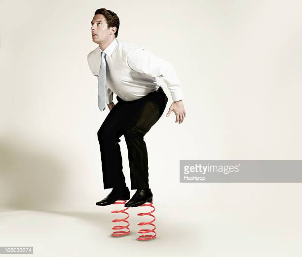 Businessman about to jump from springs
